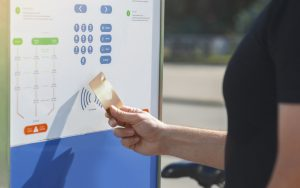 Man paying with contactless payment for bicycle